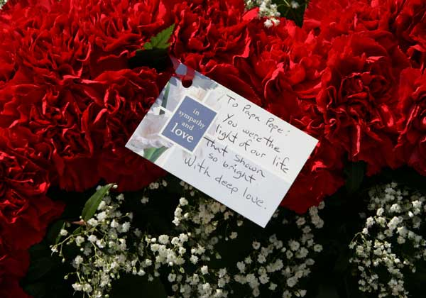 "<div class=""meta ""><span class=""caption-text "">A floral display with a note to 'Papa Pope' stands under a statue of Pope John Paul II outside St. Helen's church Tuesday, April, 5, 2005 in Chicago. Though it's been more than 25 years since Pope John Paul II came to this city, for many his presence still lingers. Chicago has one of the largest Polish populations outside of Warsaw and some Poles here say the pope's death hurts a bit deeper because he was one of their own.  ( (AP Photo/M. Spencer Green))</span></div>"
